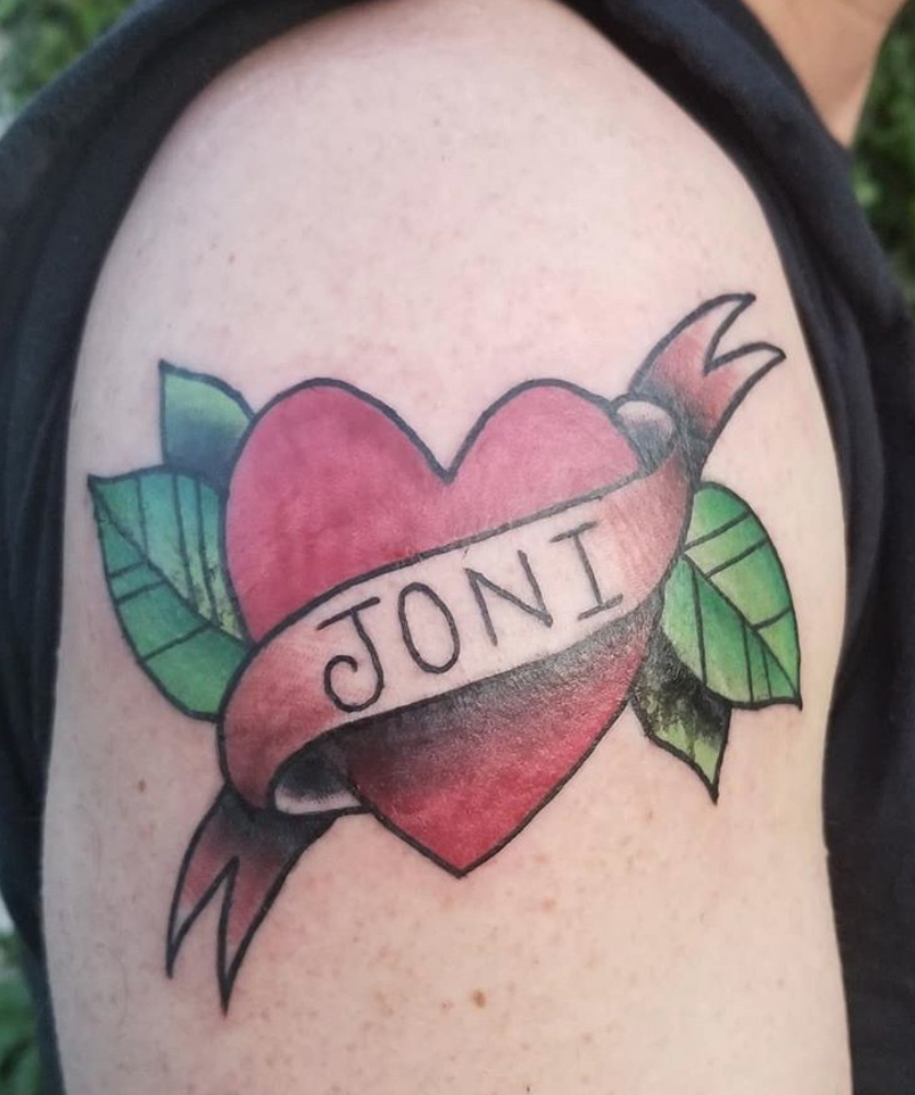 Couples traditional heart name tattoo.