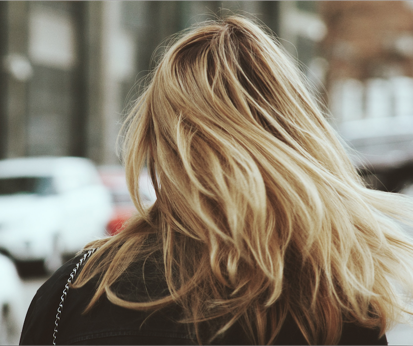 Keeping dyed blonde hair moisturized is a lot of work, friends. (Image Credit: Unsplash/Alex Suprun)