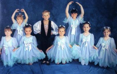 Writer at six years old, photographed at a local ballet school