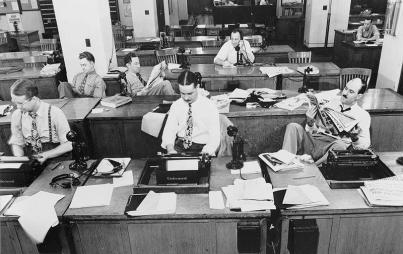 Male reporters at the New York Times office circa 1942. Has much changed since then? (Credit: Wikimedia Commons)